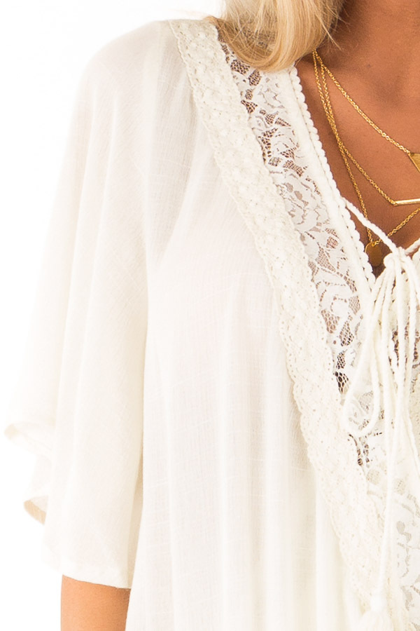 Cream Lace Surplice Top with Front Tassel Tie detail