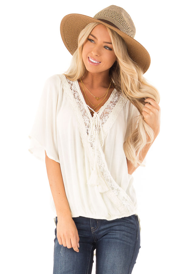 Cream Lace Surplice Top with Front Tassel Tie front close up