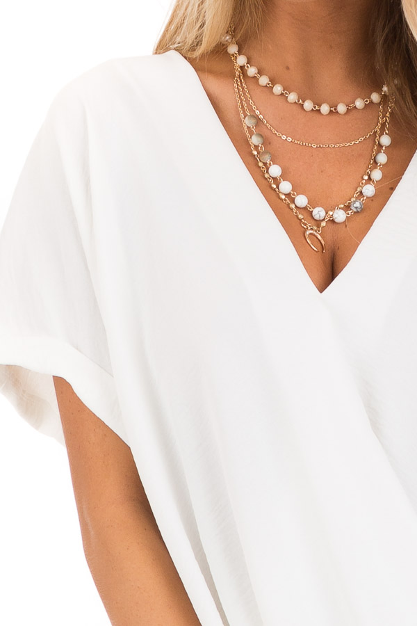 Coconut V Neck Surplice Top with Short Cuffed Sleeves detail