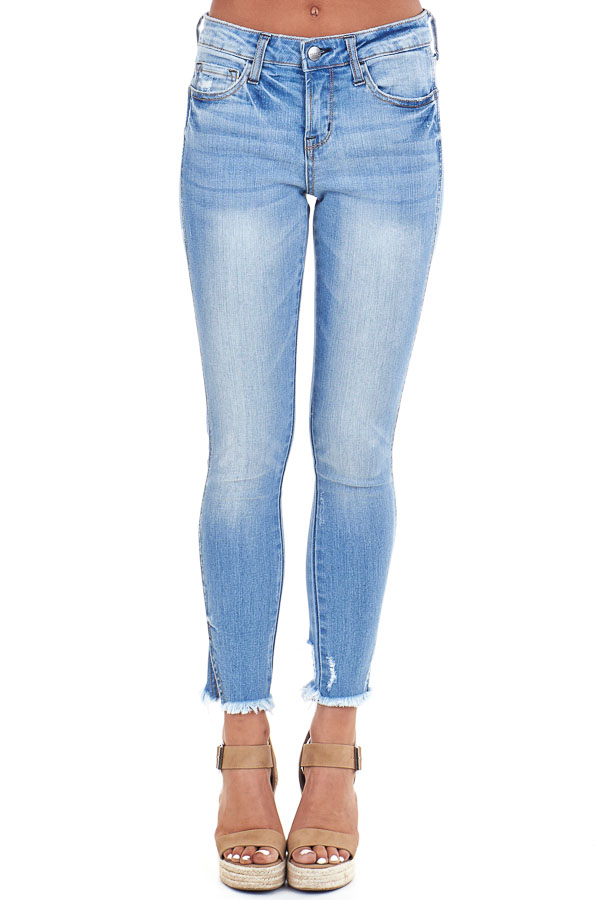 Light Wash Mid Rise Skinny Jeans with Distressed Hemline front view