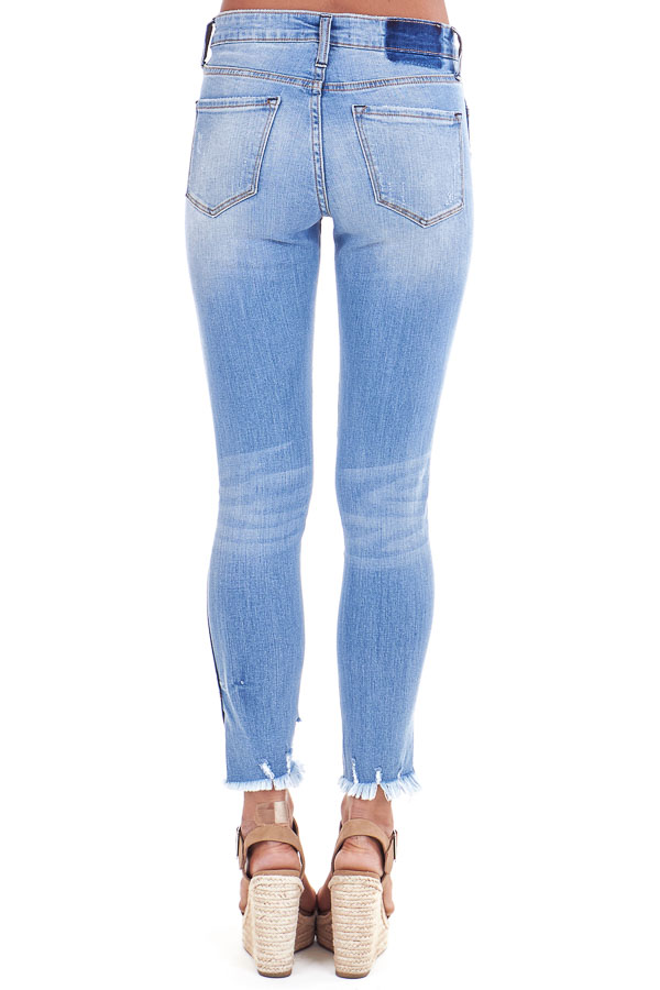 Light Wash Mid Rise Skinny Jeans with Distressed Hemline back view