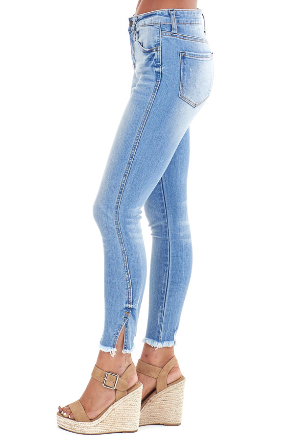 Light Wash Mid Rise Skinny Jeans with Distressed Hemline side view