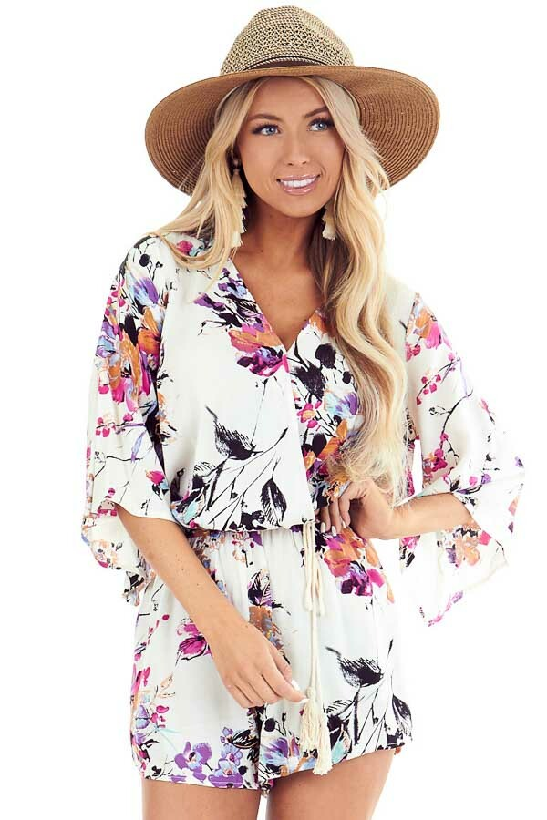 Off White Floral Print Romper with Tassel Waist Tie front close up