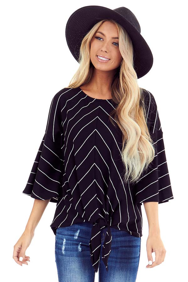 Black and Ivory Striped Trumpet Sleeve Top with Front Tie front close up