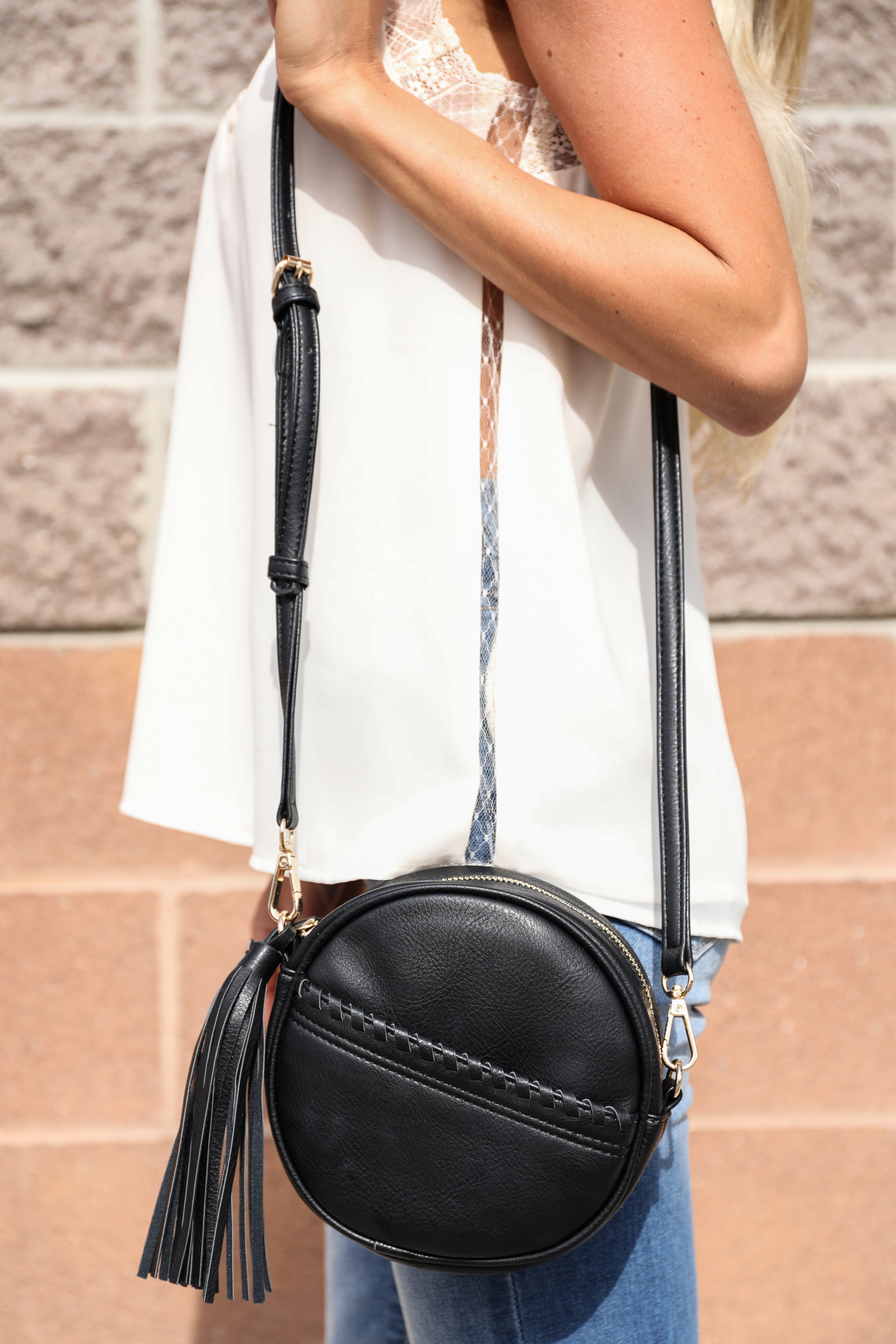 Black Faux Leather Round Cross Body Bag with Tassel Detail