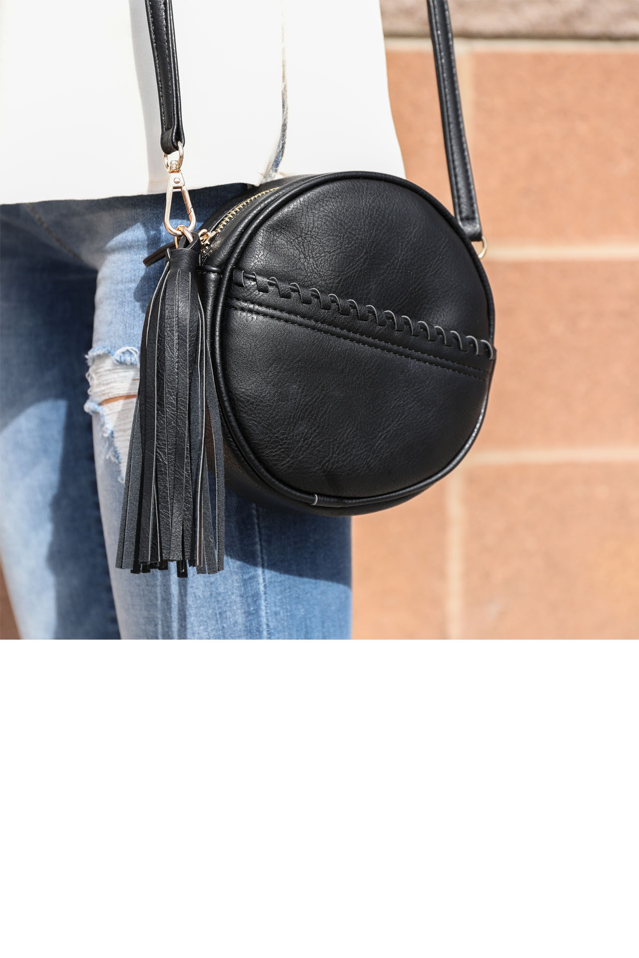 Black Faux Leather Round Cross Body Bag with Tassel Detail detail