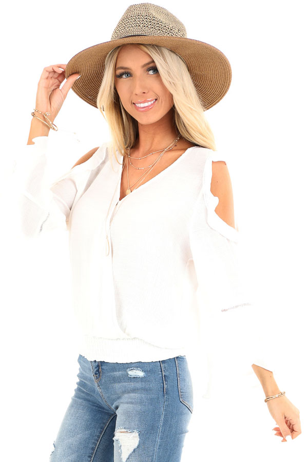 Snowy White Cold Shoulder Surplice Top with Ruffle Details front close up