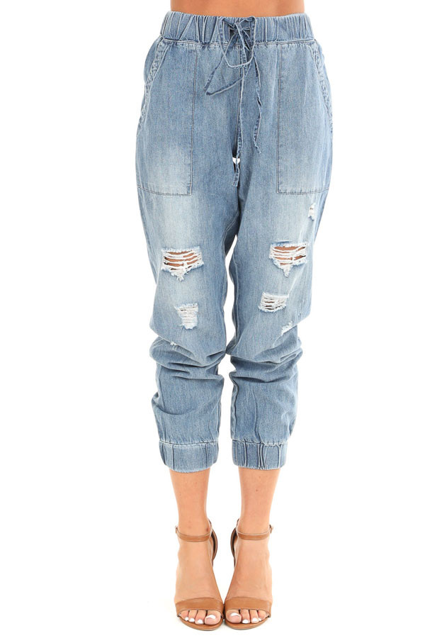 Medium Wash Distressed Denim Joggers with Waist Tie Detail front view