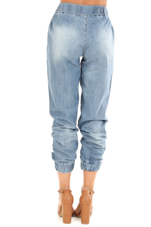 Medium Wash Distressed Denim Joggers with Waist Tie Detail back view