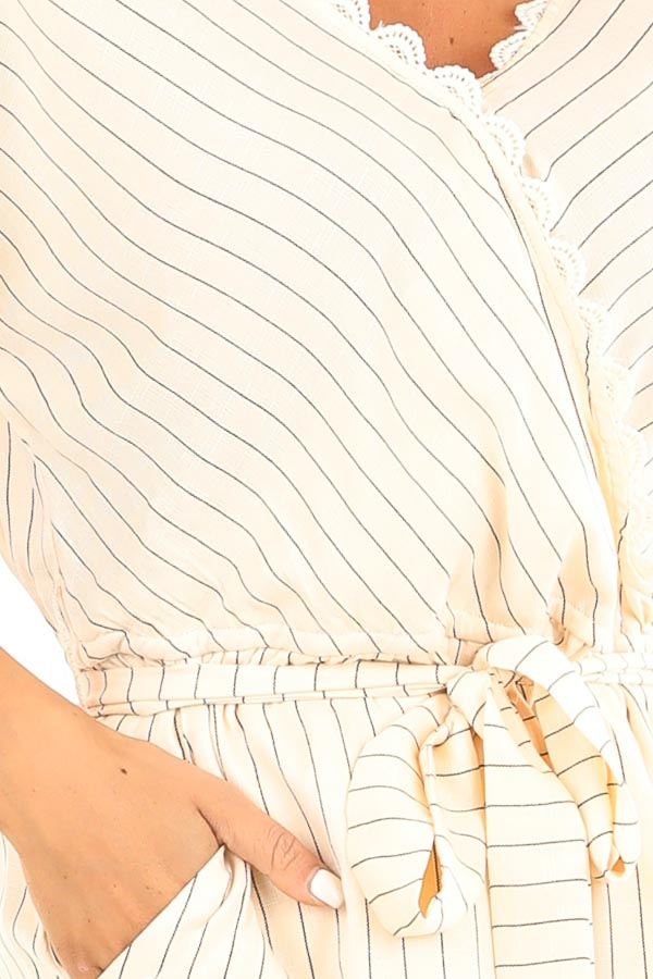 Cream Striped Surplice Romper with Pockets and Waist Tie detail
