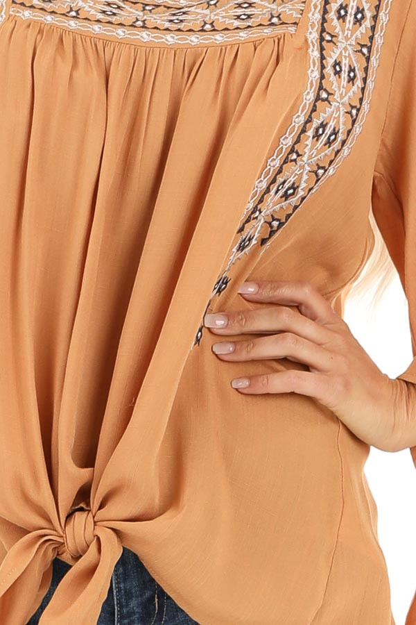 Caramel Top with 3/4 Bell Sleeves and Embroidered Details detail