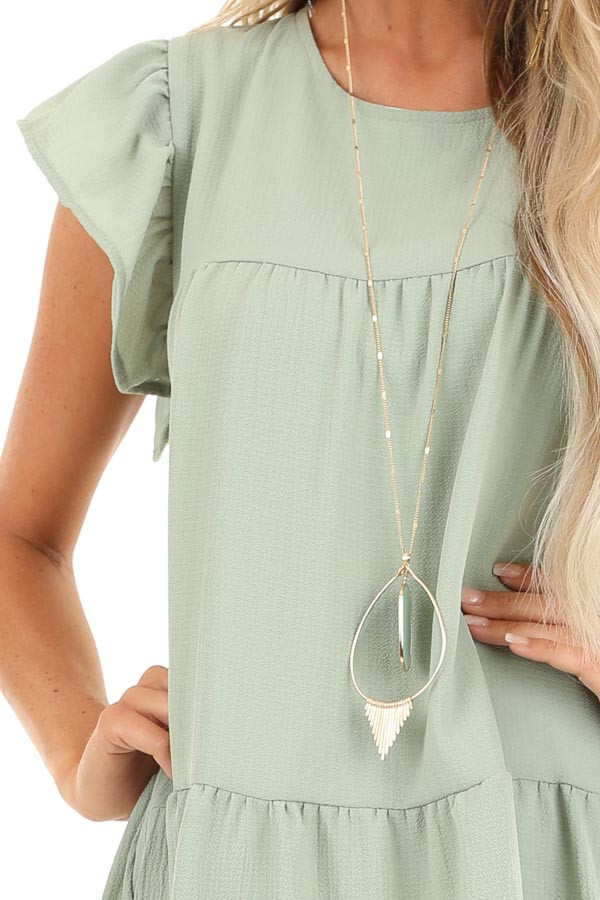 Sage Crew Neck Babydoll Dress with Ruffled Sleeves detail