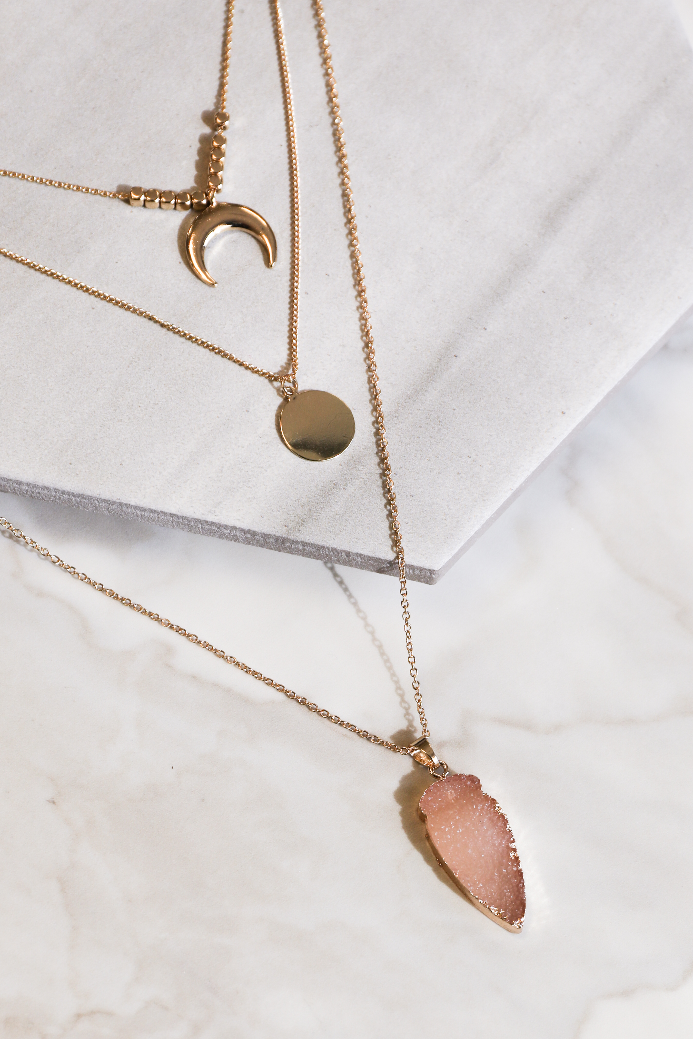 Gold Layered Necklace with Pale Pink Stone Pendant close up