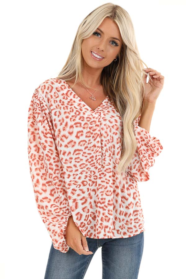 Ivory and Blush Animal Print Long Sleeve Top with V Neckline front close up