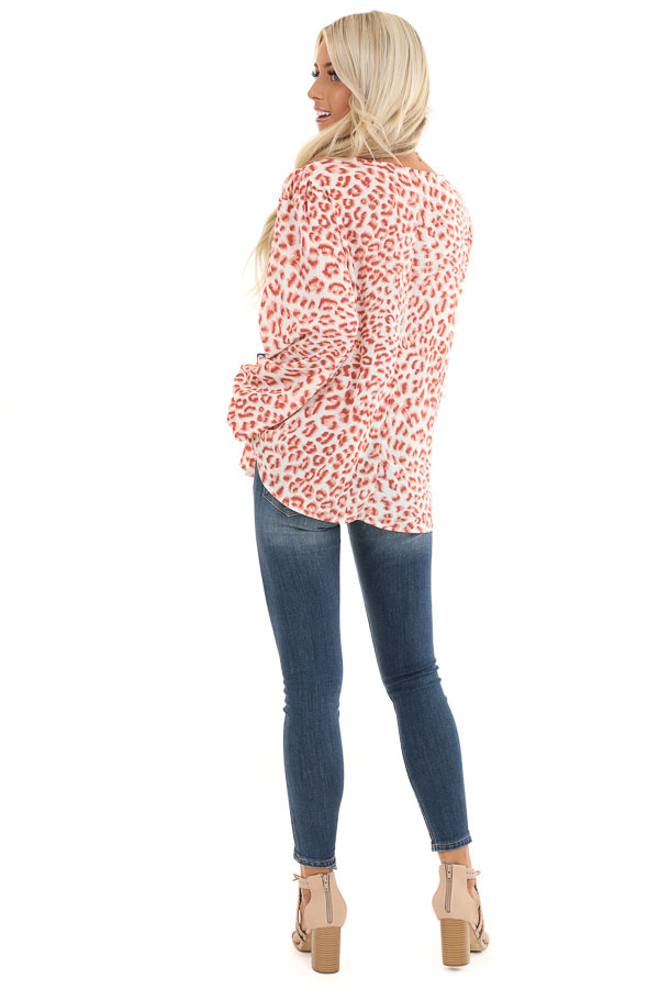 Ivory and Blush Animal Print Long Sleeve Top with V Neckline back full body