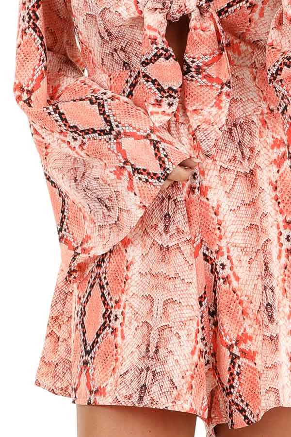 Coral Snakeskin Print Long Bell Sleeve Romper with Front Tie detail