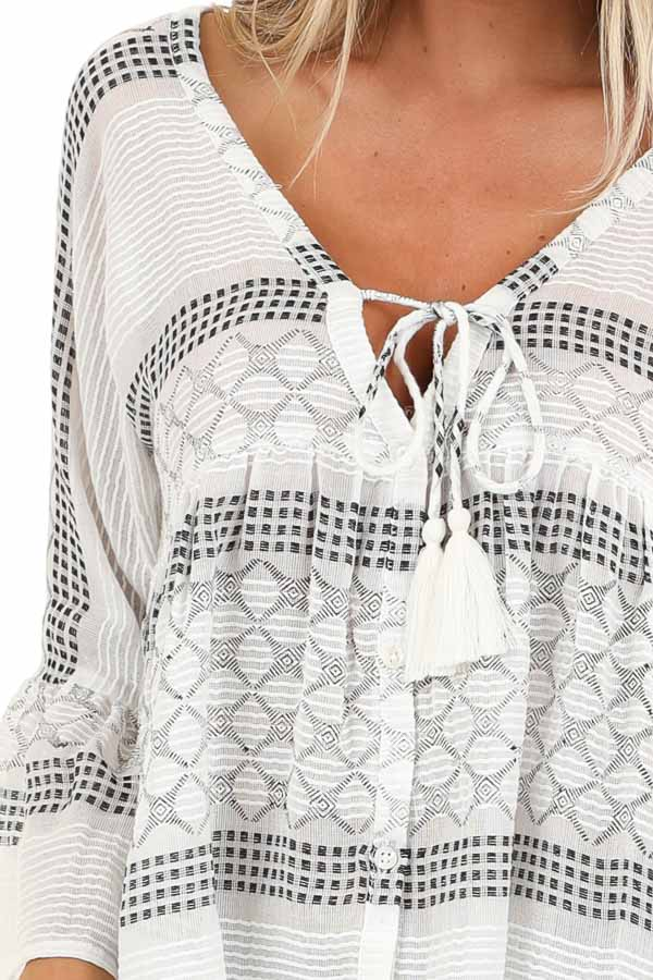 Ivory and Black Print V Neck Button Up Top with Bell Sleeves detail