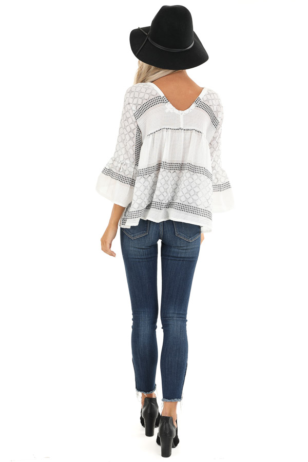 Ivory and Black Print V Neck Button Up Top with Bell Sleeves back full body