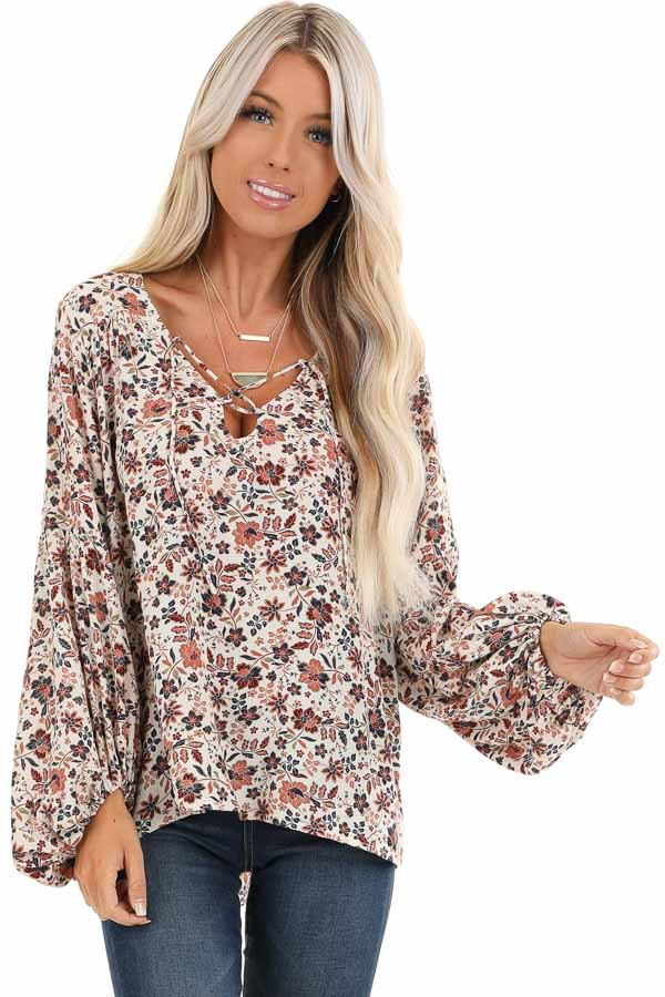 Ivory Floral Print Long Sleeve Top with Lace Up Details front close up