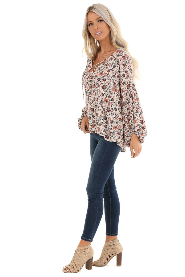 Ivory Floral Print Long Sleeve Top with Lace Up Details side full body