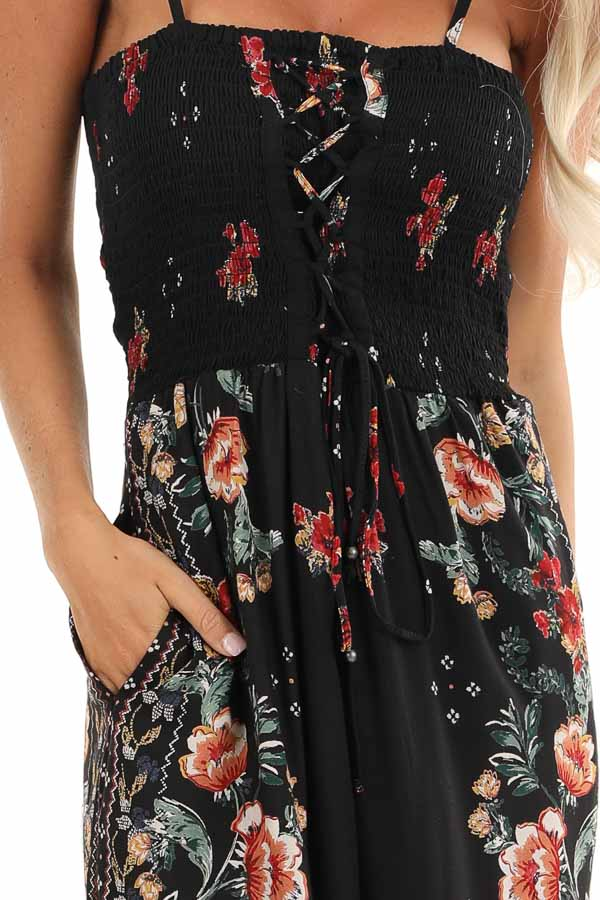 Ink Black Floral Print Jumpsuit with Smocked Lace Up Bodice detail