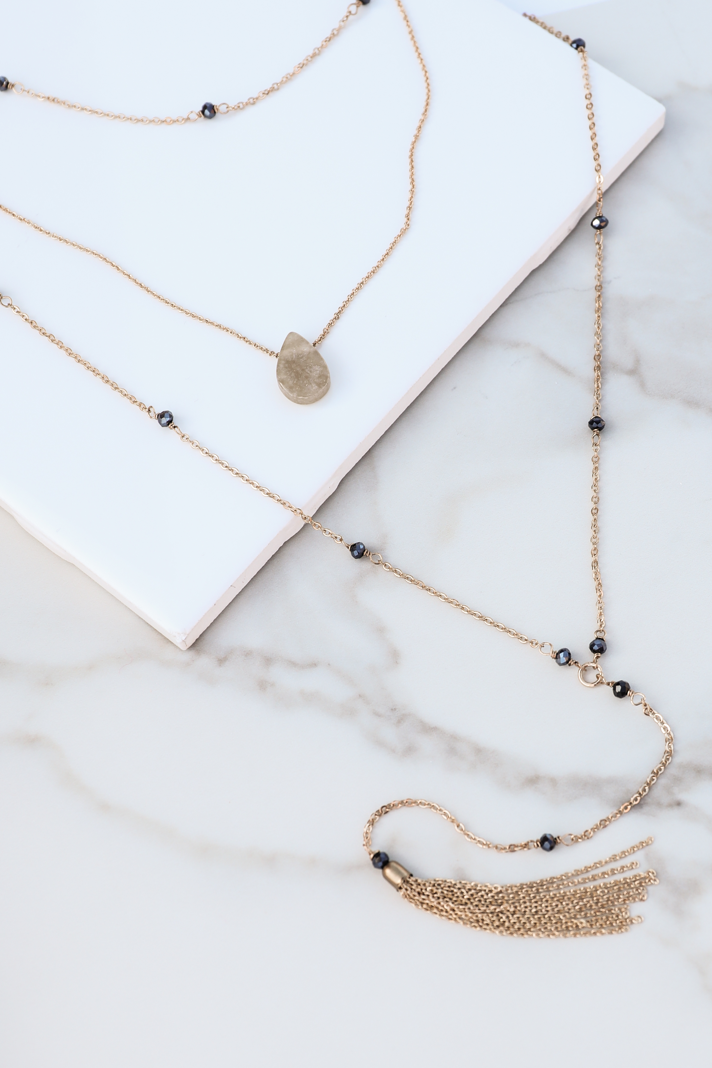 Gold Layered Necklace with Navy Beading and Tassel Detail