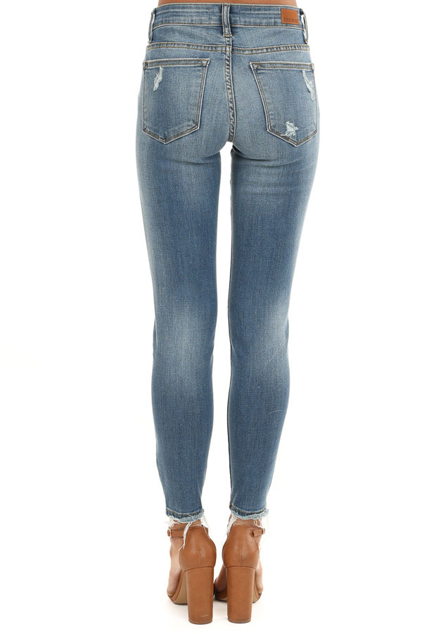 Medium Wash Distressed Denim Skinny Jeans with Frayed Ankles back view