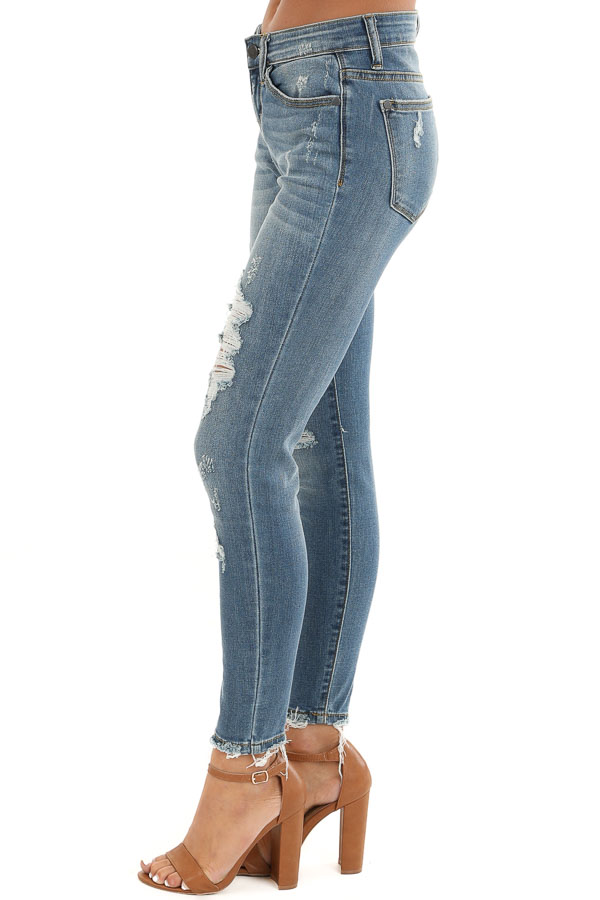 Medium Wash Distressed Denim Skinny Jeans with Frayed Ankles side view
