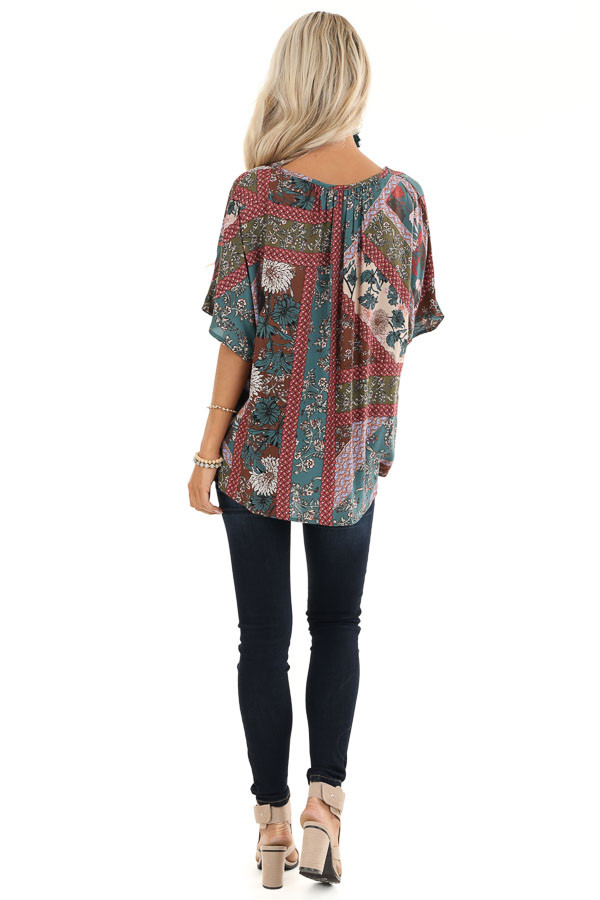 Brick and Teal Floral Print Top with V Neckline and Twist back full body