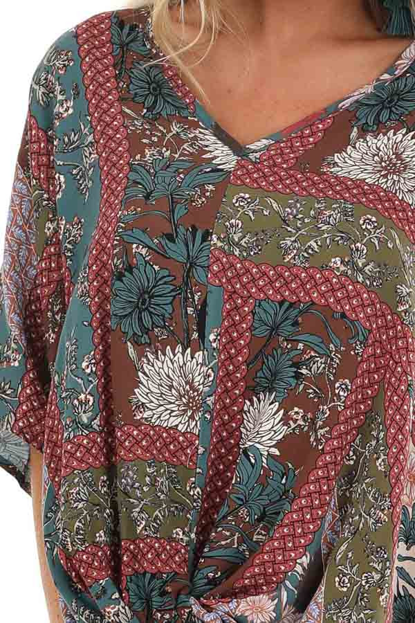 Brick and Teal Floral Print Top with V Neckline and Twist detail