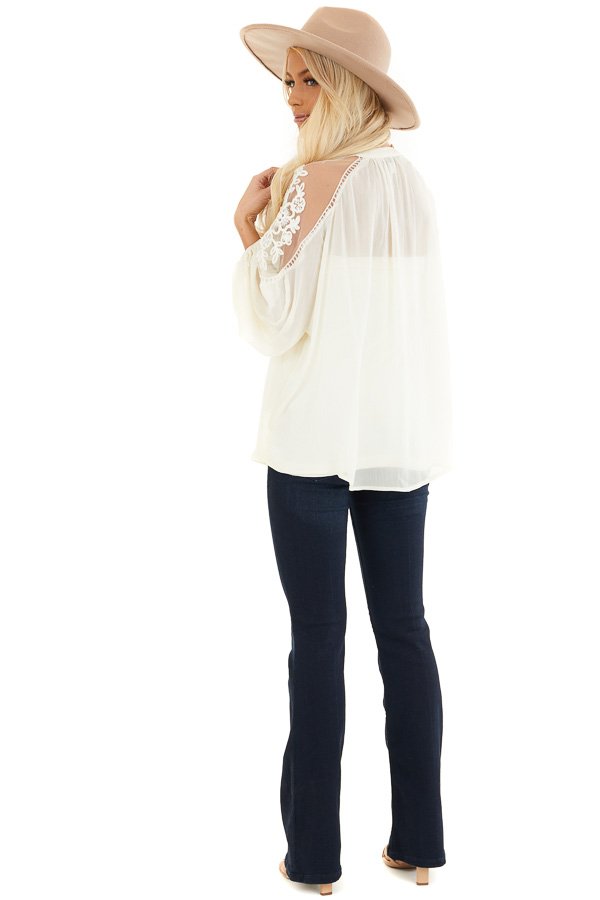 Cream Blouse with Sheer Lace Yoke and Tie Neckline back full body