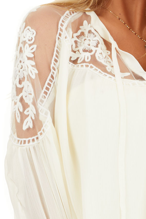 Cream Blouse with Sheer Lace Yoke and Tie Neckline detail