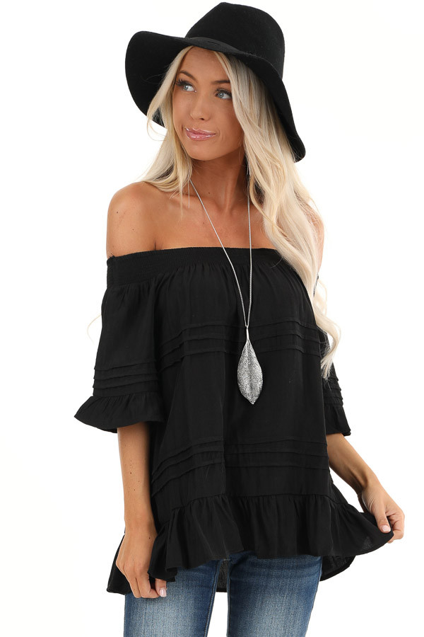 Black Off the Shoulder Top with Ruffle Details front close up