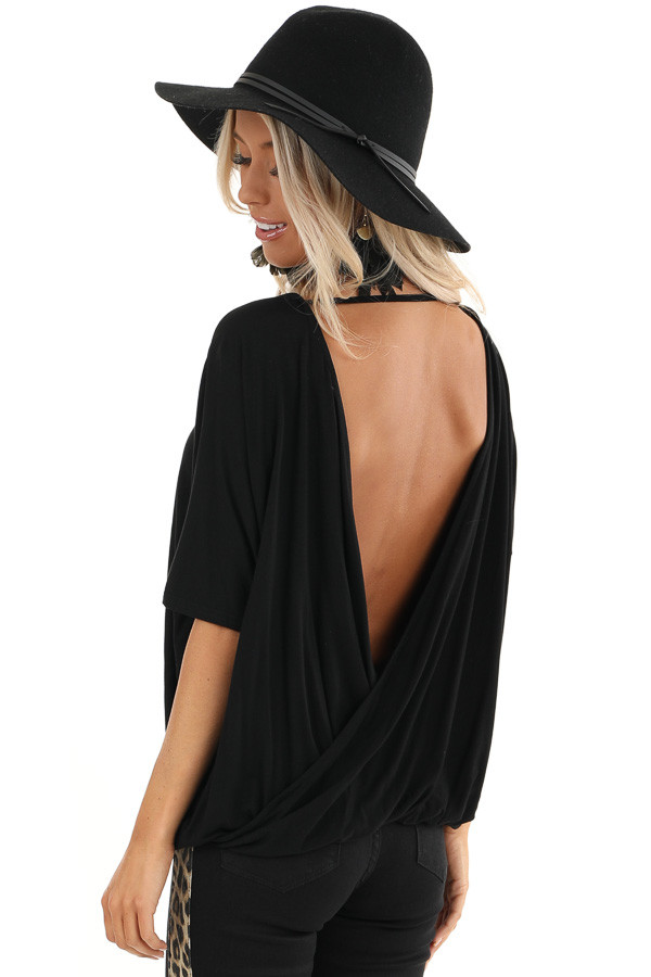 Black Surplice Short Sleeve Top with Deep Open Back back side close up
