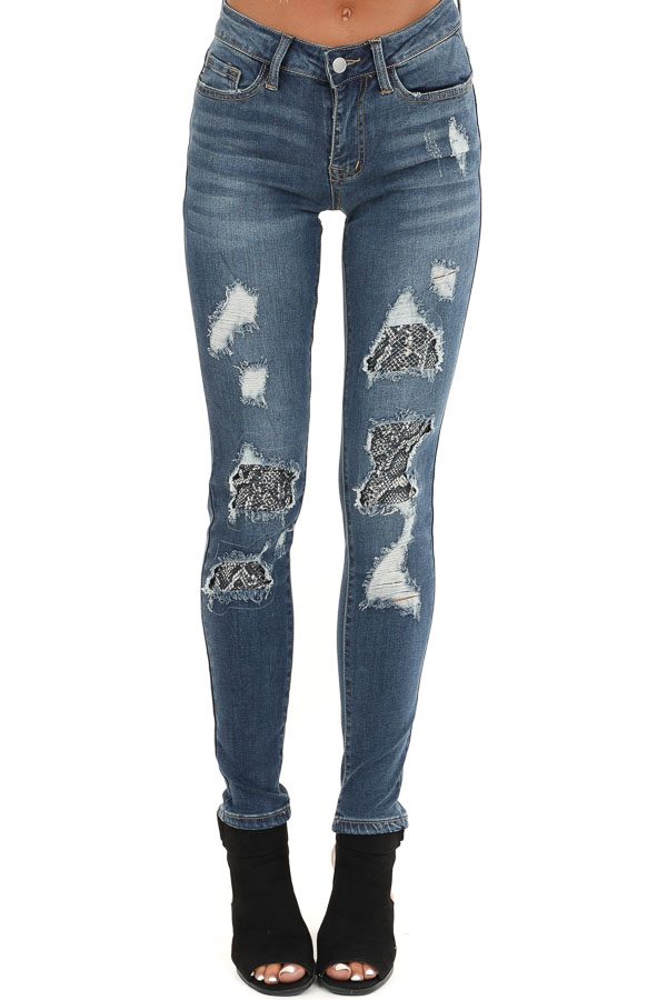 Medium Wash Denim Distressed Snakeskin Skinny Jeans front view