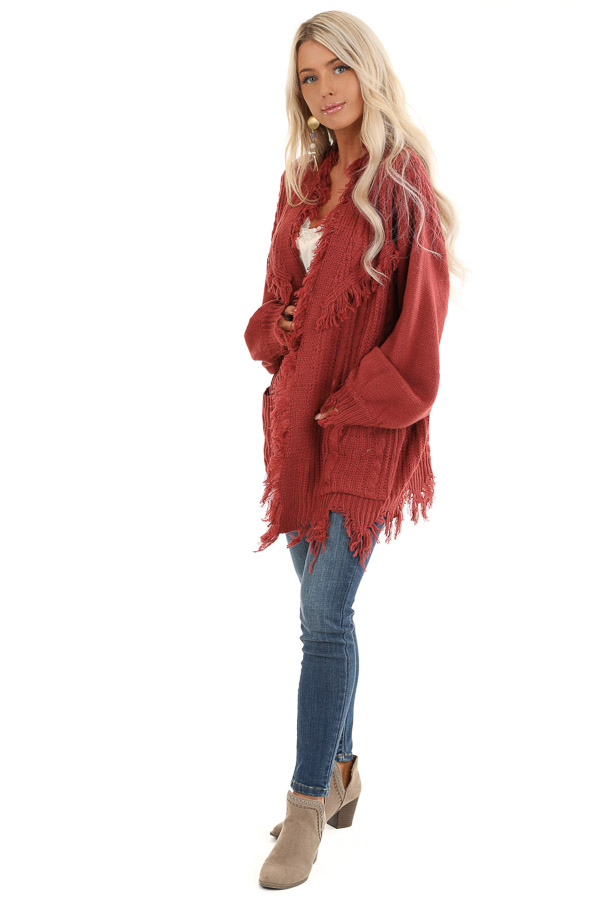 Rust Cable Knit Cardigan with Raw Cut Edges and Pockets front full body