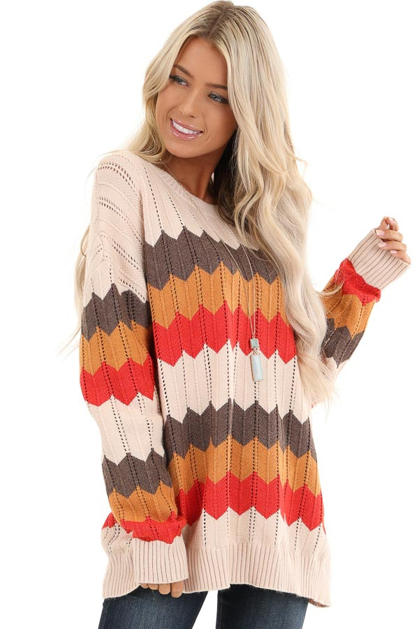 Cream and Orange Chevron Striped Pullover Sweater front close up