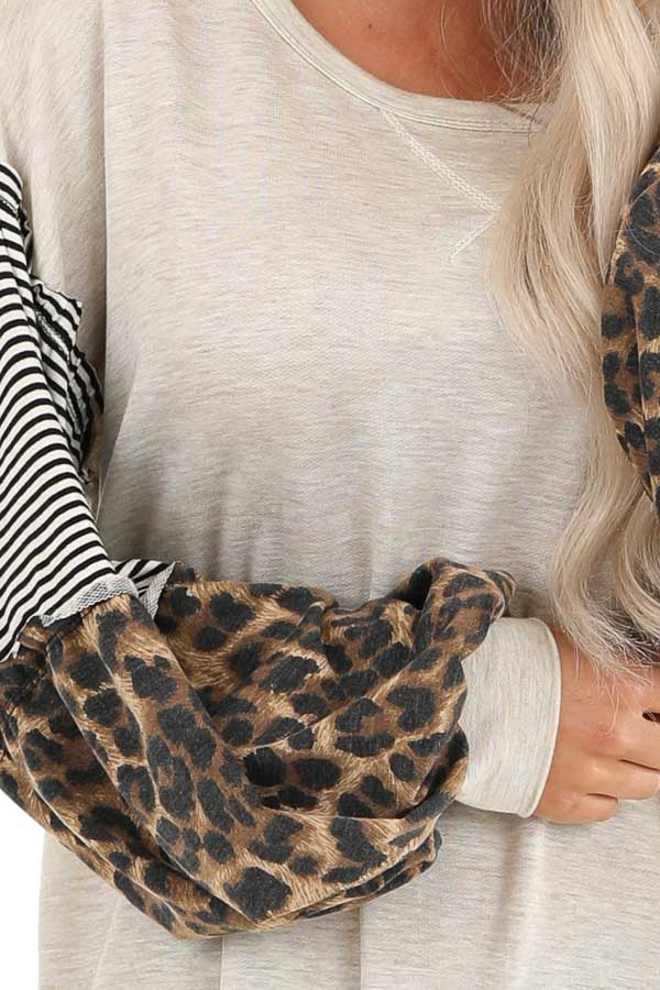 Oatmeal Top with Leopard and Striped Color Block Sleeves detail