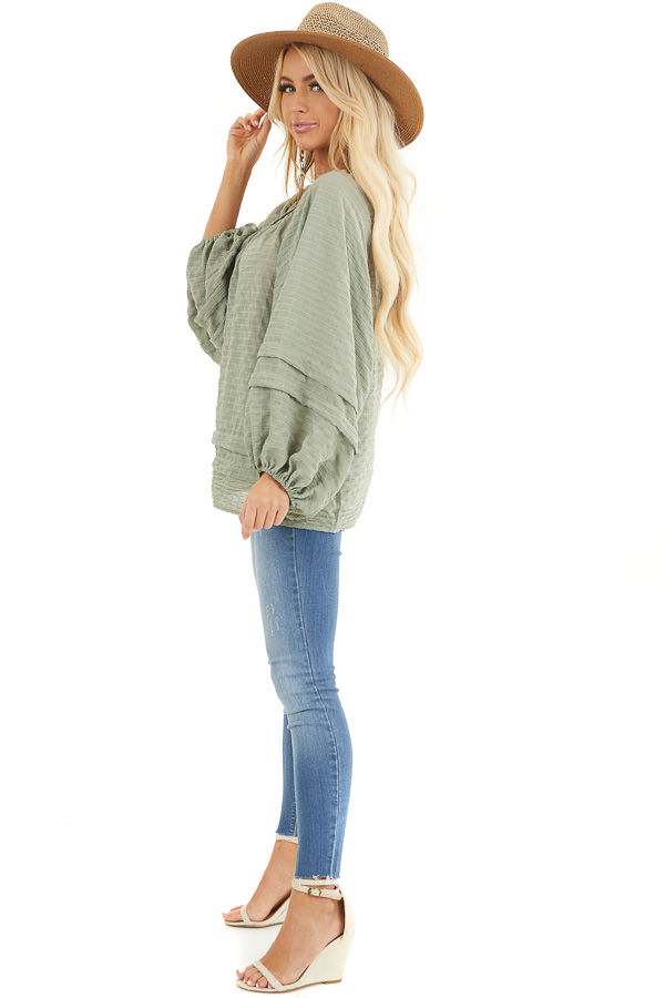 Sage Textured Long Sleeve Loose Fit Blouse with Layered Hem side full body