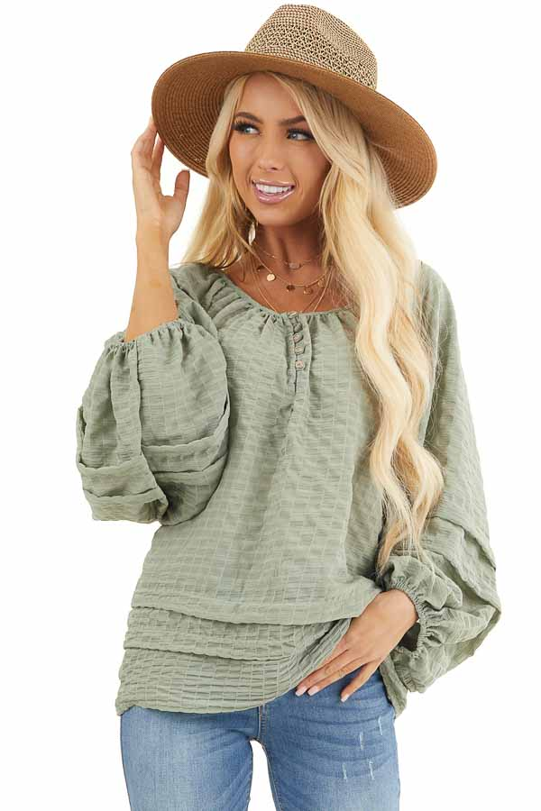 Sage Textured Long Sleeve Loose Fit Blouse with Layered Hem front close up