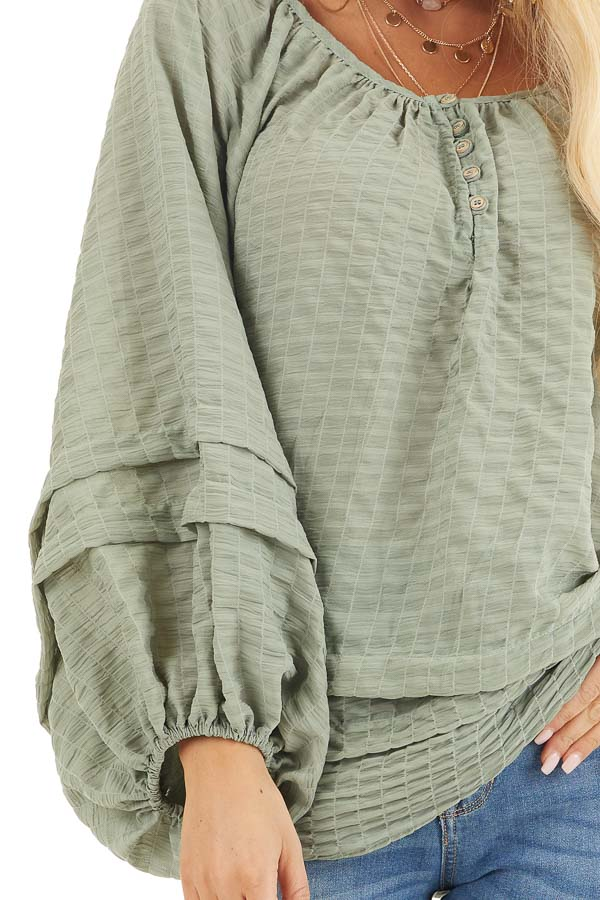 Sage Textured Long Sleeve Loose Fit Blouse with Layered Hem detail