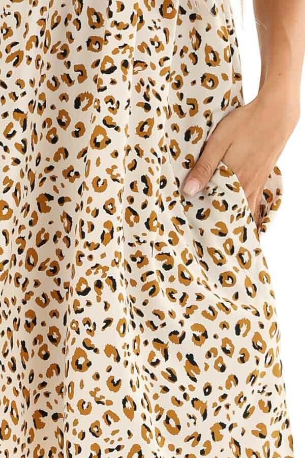 Ivory and Caramel Leopard Print V Neck Babydoll Mini Dress detail