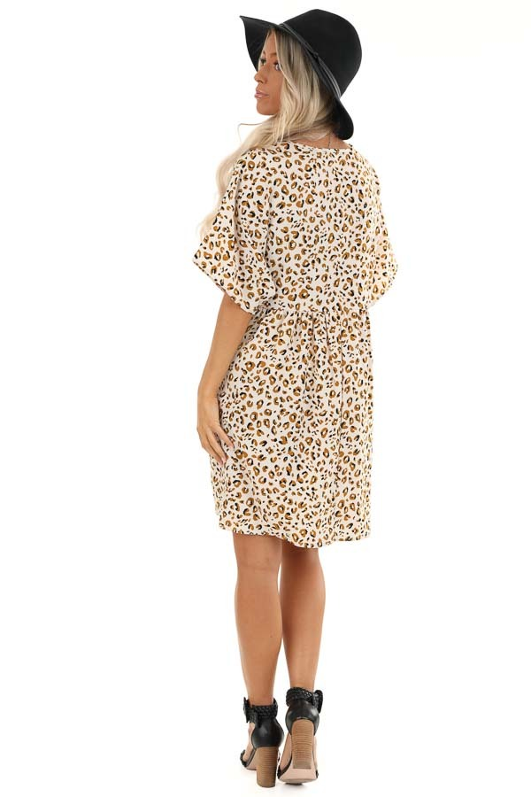 Ivory and Caramel Leopard Print V Neck Babydoll Mini Dress back full body