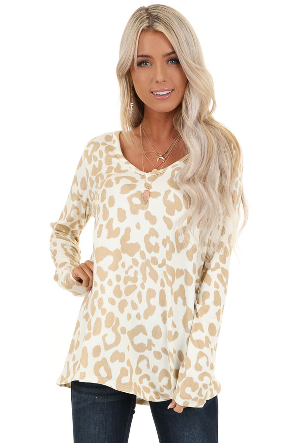 Ivory and Taupe Animal Print V Neck Top with Long Sleeves front close up