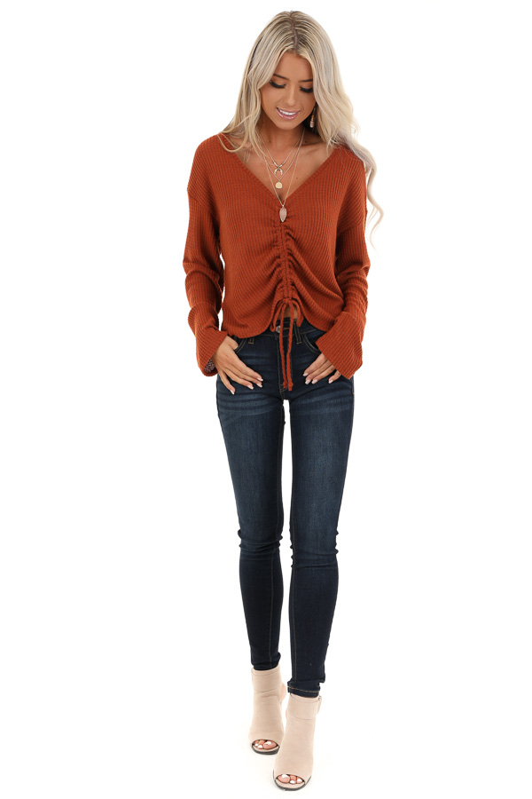 Rust V Neck Long Sleeve Top with Front Drawstring Detail front full body