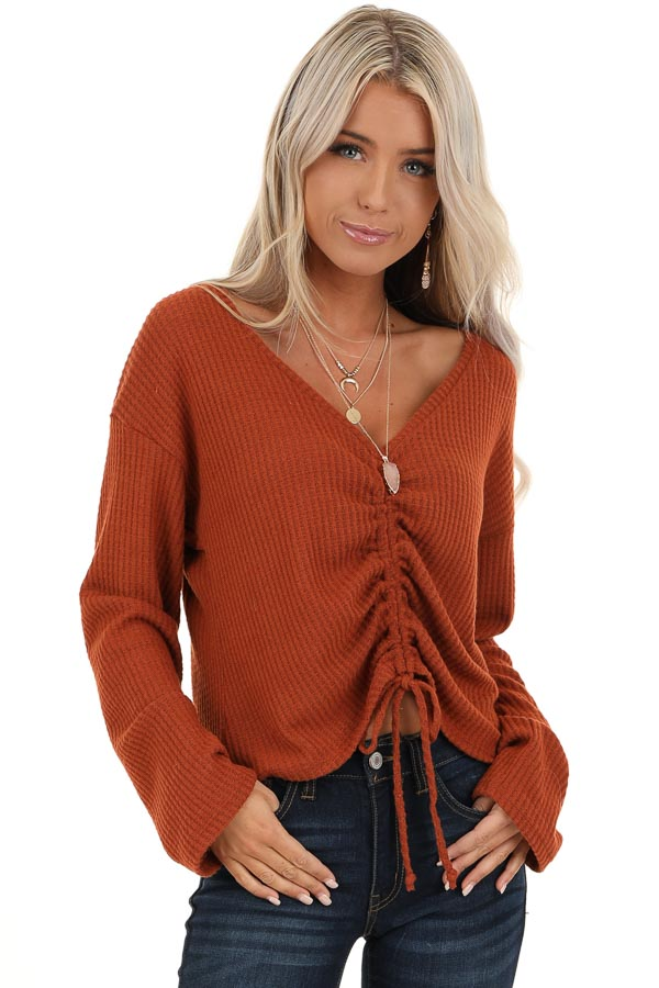 Rust V Neck Long Sleeve Top with Front Drawstring Detail front close up