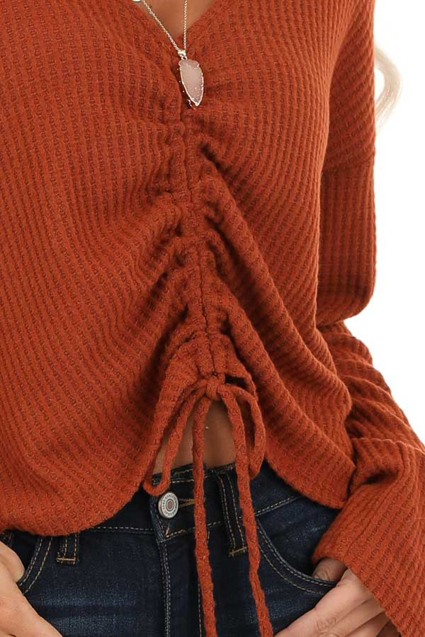Rust V Neck Long Sleeve Top with Front Drawstring Detail detail