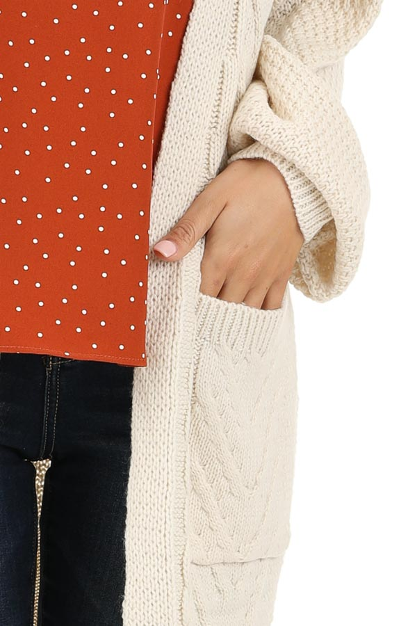 Cream Cable Knit Cardigan with Long Sleeves detail