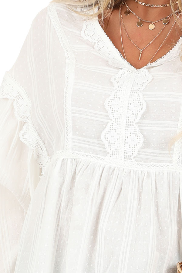 Daisy White Long Sleeve Peplum Blouse with Crochet Lace Trim detail