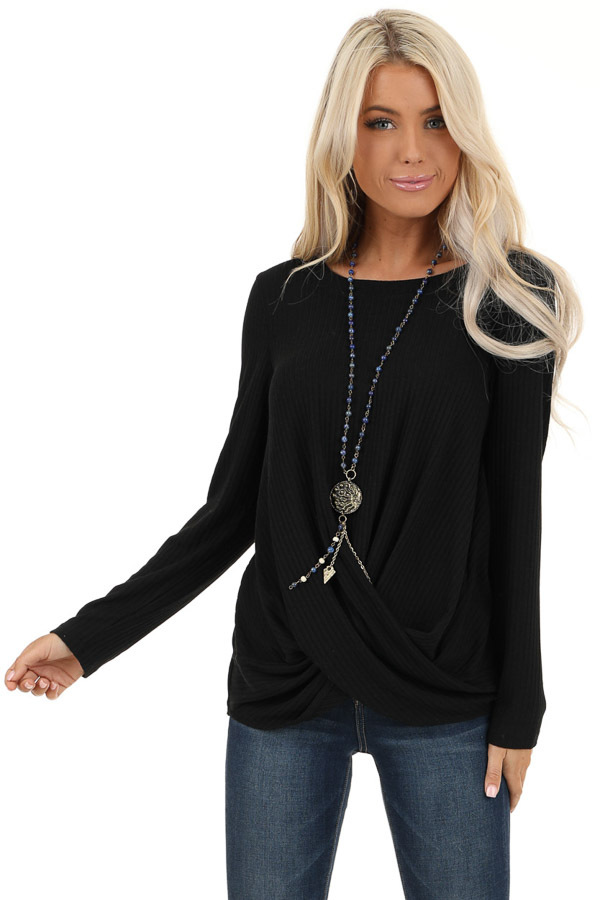 Black Ribbed Knit Top with Long Sleeves and Twisted Hemline front close up